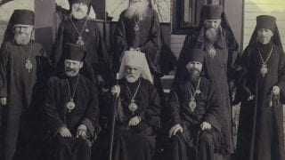 Hierarchs of North American Metropolitan. Left to right sitting: Archb Adam, Met. Theophil, Archb. Vitlay; Standing: Bps. Makary, Leonty, Tikhon, Arseny, unidentified bishop. The late 1930s
