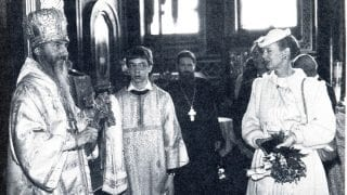 At the millennium celebrations Bishop Mark presents Queen Margaret with a memorial medal